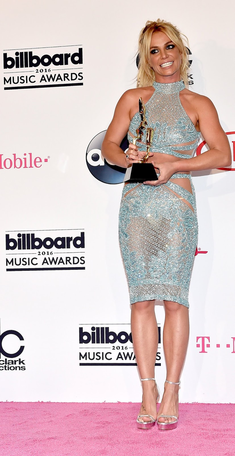 She did put on a sparkly shirt/skirt combo to accept her Millennium Award
