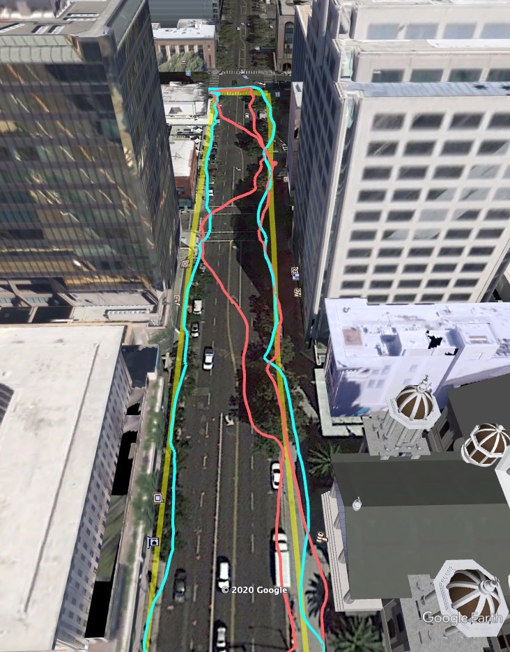 Picture of a pedestrian test, with Pixel 5 phone, walking along one side of the street, then the other. Yellow = Path followed, Red = without 3D mapping aided corrections, Blue = with 3D mapping aided corrections. The picture shows that without 3D mapping aided corrections, the GPS results frequently wander to the wrong side of the street (or even the wrong city block), whereas, with 3D mapping aided corrections, the position is many times more accurate.