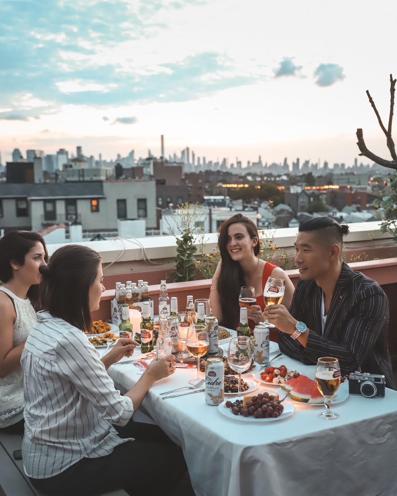 Stella Artois Cheers with Friends on NYC Rooftop, AMWF Couple