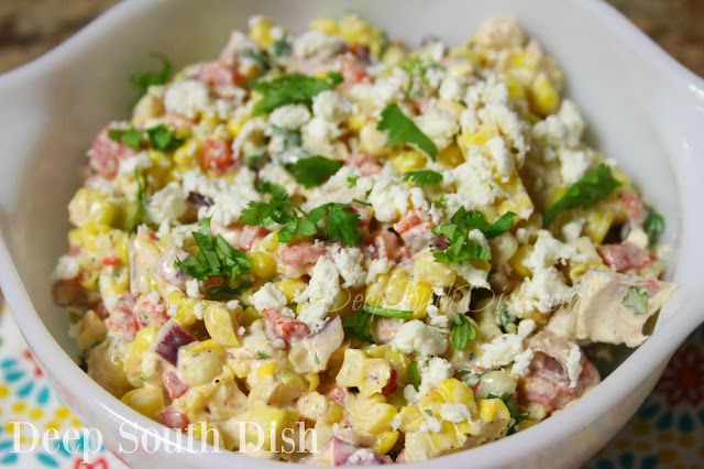 A corn salad made in the tradition of Mexican Street Corn on the Cob, with fresh cooked corn and dressed with a mayo and sour cream mixture of Cotija cheese, chili powder, cilantro, lime juice and zest. Toss in some crisp veggies, chill well and garnish with a little more cheese and cilantro.
