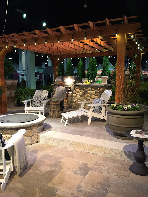 I could totally get behind the idea of a fire pit and pergola backyard re-do like this one! | Boston Flower & Garden Show 2017