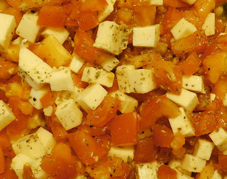diced tomatoes and cheese in a bowl