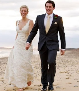 Jack Heald with his wife Becky Mantin in their wedding dress