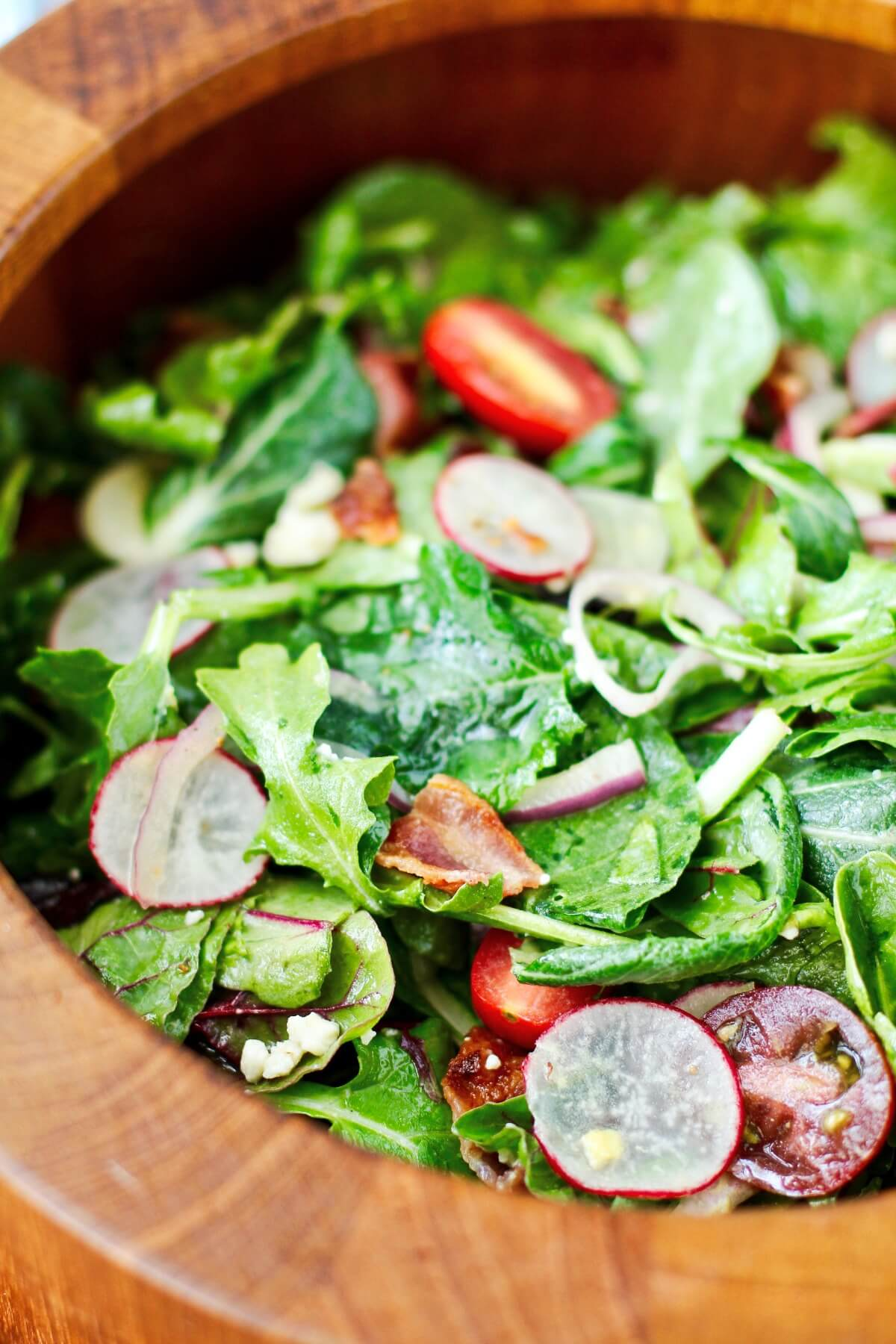 Wilted Greens salad in salad bowl