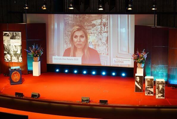 Queen Maxima wore a red blouse by Claes Iversen. Queen Maxima wore a Claes Iversen silk top