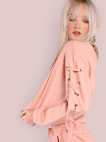 http://es.shein.com/Cropped-Lace-Up-Eyelet-Shoulder-Sweatshirt-PINK-p-323781-cat-1773.html?aff_id=8741