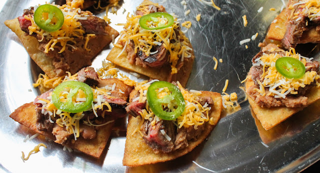 Food Lust People Love: Crunchy fried tortilla triangles topped with refried beans, fajita beef, cheese and jalapeños, these beef fajita nachos compuestos can also be made with store-bought chips. This recipe can also be a main course, as it was for me years ago. You can totally add some shredded lettuce to make you feel better about making this a full meal.