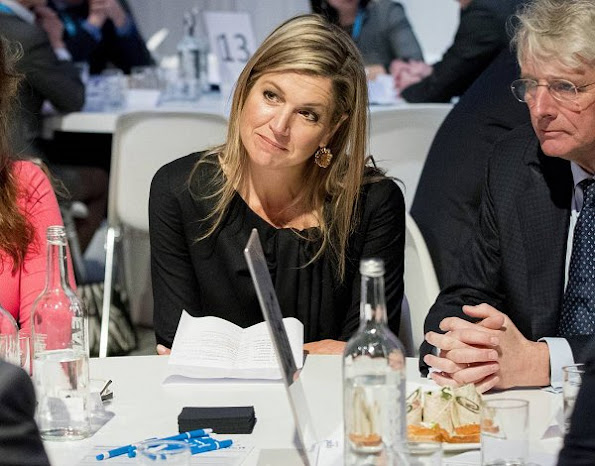 Queen Maxima wore Natan Coat and Dress, Cartier gold earrings, Natan Pups in Blue