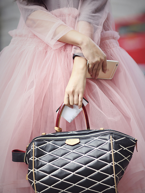 Susie Lau wears a Molly Goddard dress, Finery underneath, Dora Teymur boots, Louis Vuitton bag.