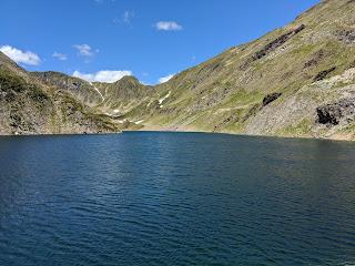 Lago di Aviasco with Passo Aviasco in the distance.