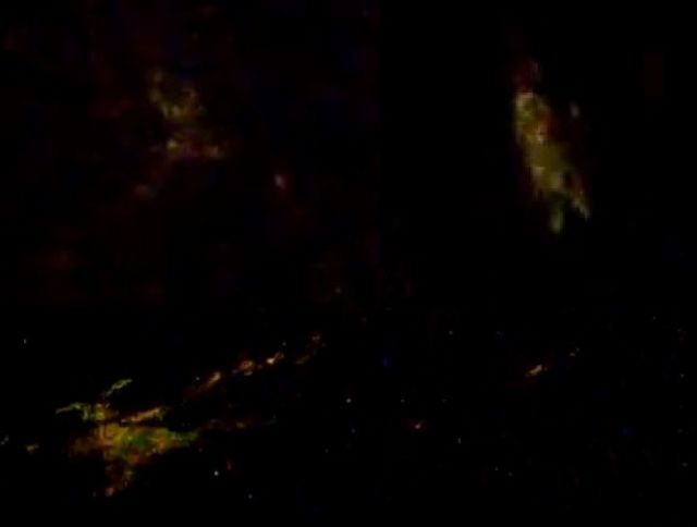 Oddly-shaped entities flying over the Pacific ocean seen on ISS live feed  Space-anomalies-entities-iss-live-feed%2B%25282%2529
