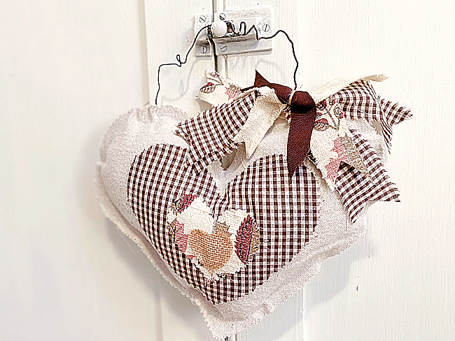 stuffed hearts with brown fabric and bow