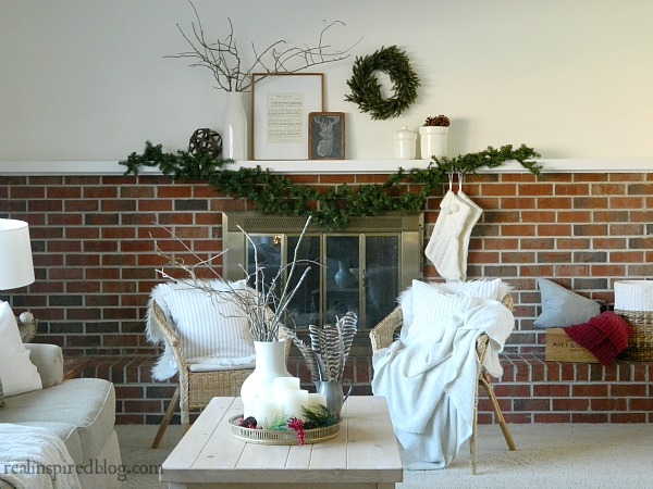 How to Decorate a Long Mantel: Christmas, greenery, wreath, sticks, vase, chalkboard, pinecone. sheet music