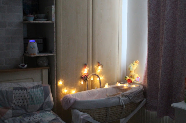baby's bedtime routine moses basket with fairy lights and blackout curtains