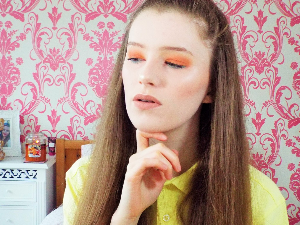 Looking to the side to show blending with the tones of orange shades on the eye lid