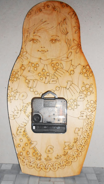 Matryoshka Wall Clocks with a surprise. On the back side of the clock is drawn (scorched) a girl-Matryoshka  that you or your child can colorize by yourself.