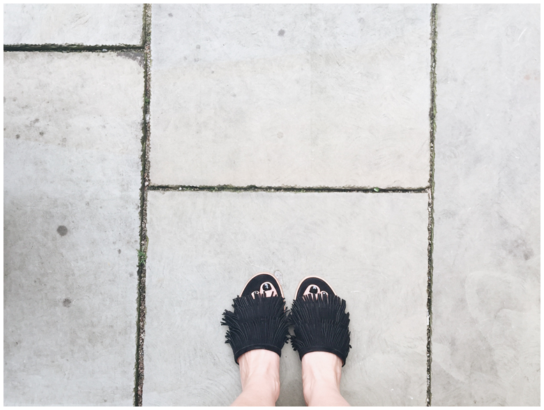 BLACK LEOPARD | June Gold wearing black & other stories fringed slip on sandals
