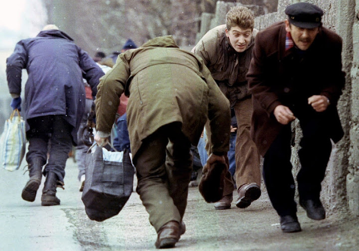 People running for cover from Serb sniper fire in Sarajevo in 1993