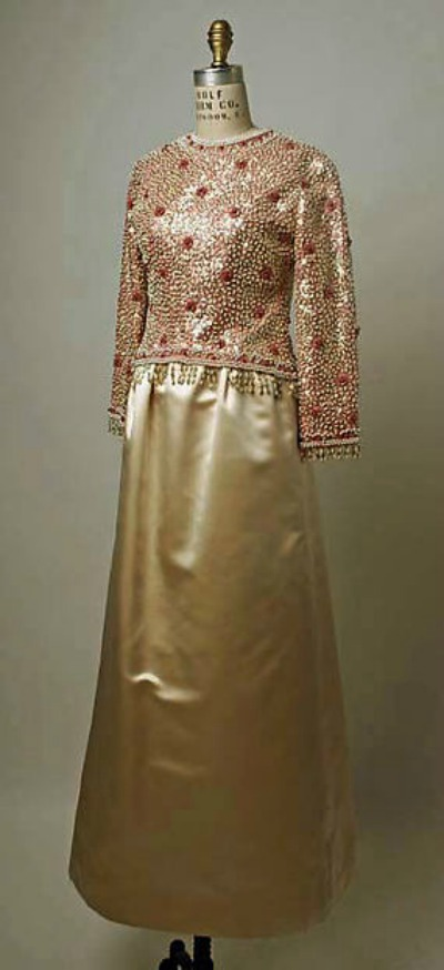 Long evening gown by Yves Saint Laurent for Fall/Winter 1962/63 displayed on dress form