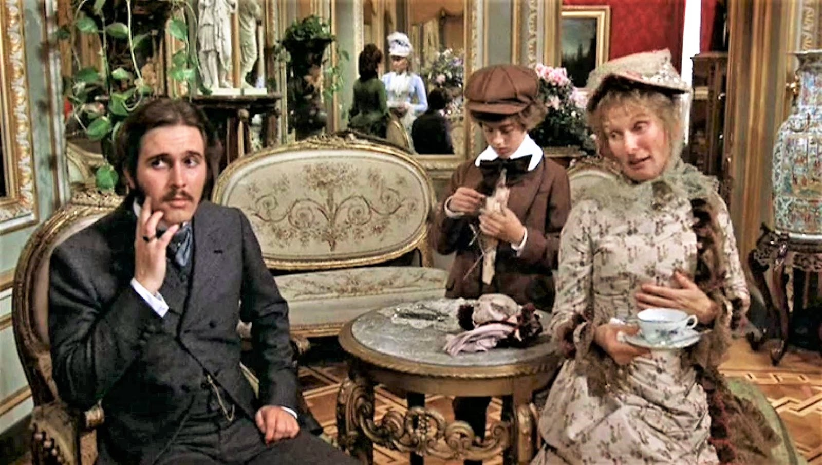 dreams are what le cinema is for daisy miller  in this beautifully composed shot mr winterbourne keeps his eye on daisy seen in the mirror behind him talking to the hostess mrs walker while mrs