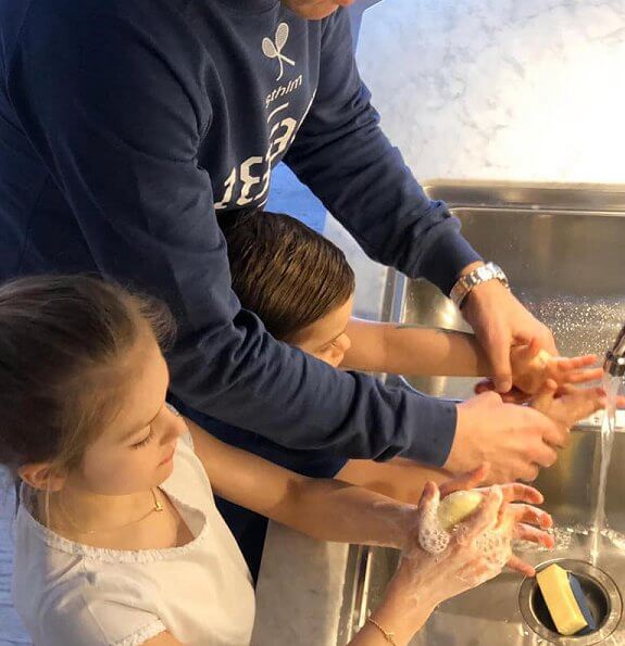Princess Estelle and Prince Oscar are seen carefully washing their hands. Crown Princess Victoria and Prince Daniel