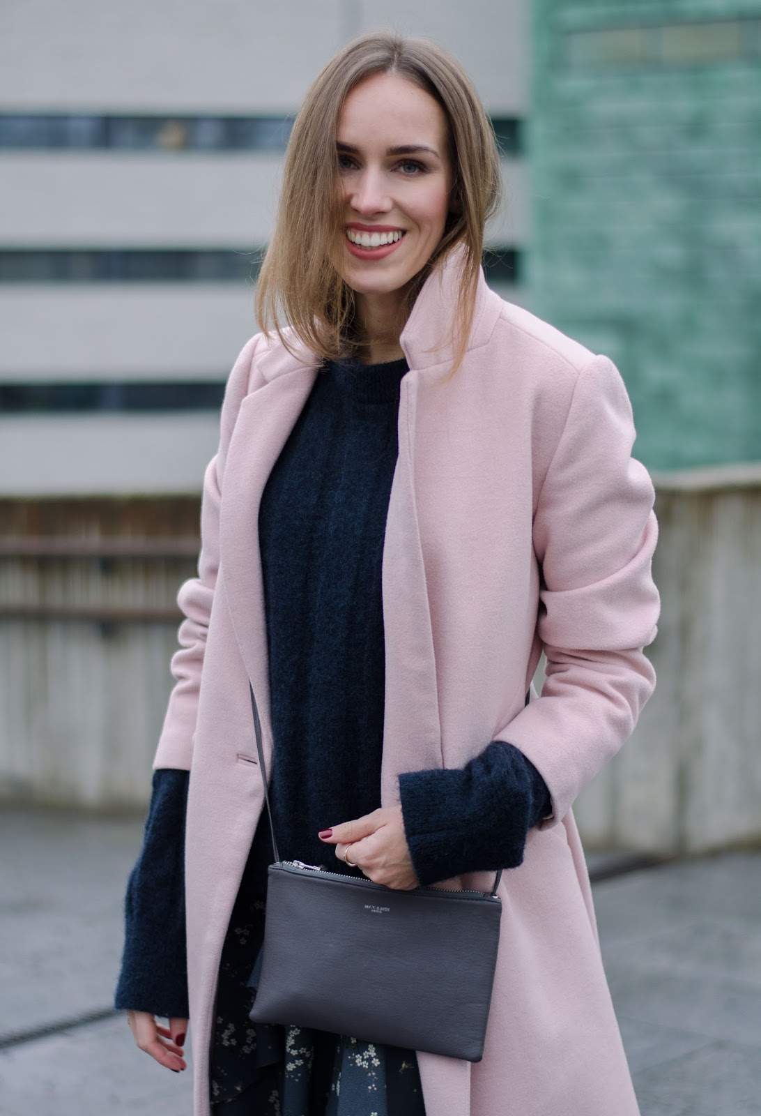 pink coat blue sweater outfit