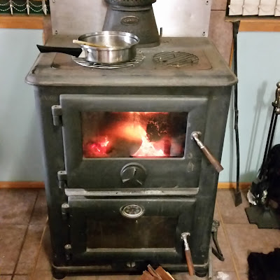eight acres: how to choose a woodstove for heating and cooking