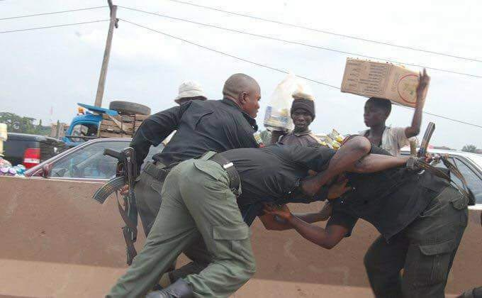 Caption these pictures of three policemen seen on the road