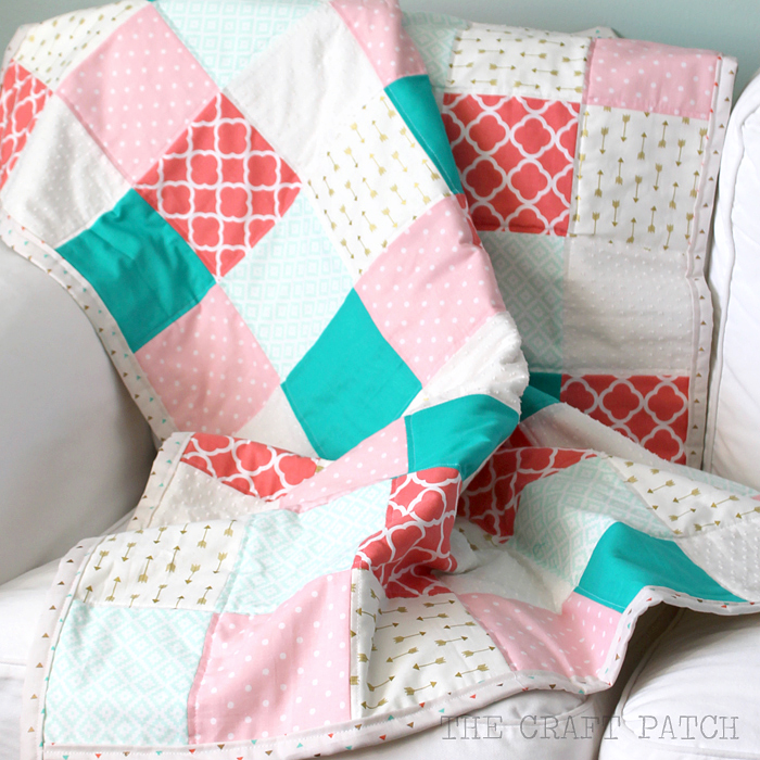 A simple quilt with a modern color scheme and trendy fabric