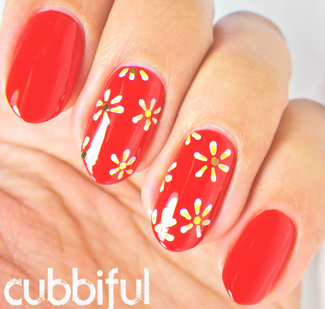 Cute White Daisies and Red Nails