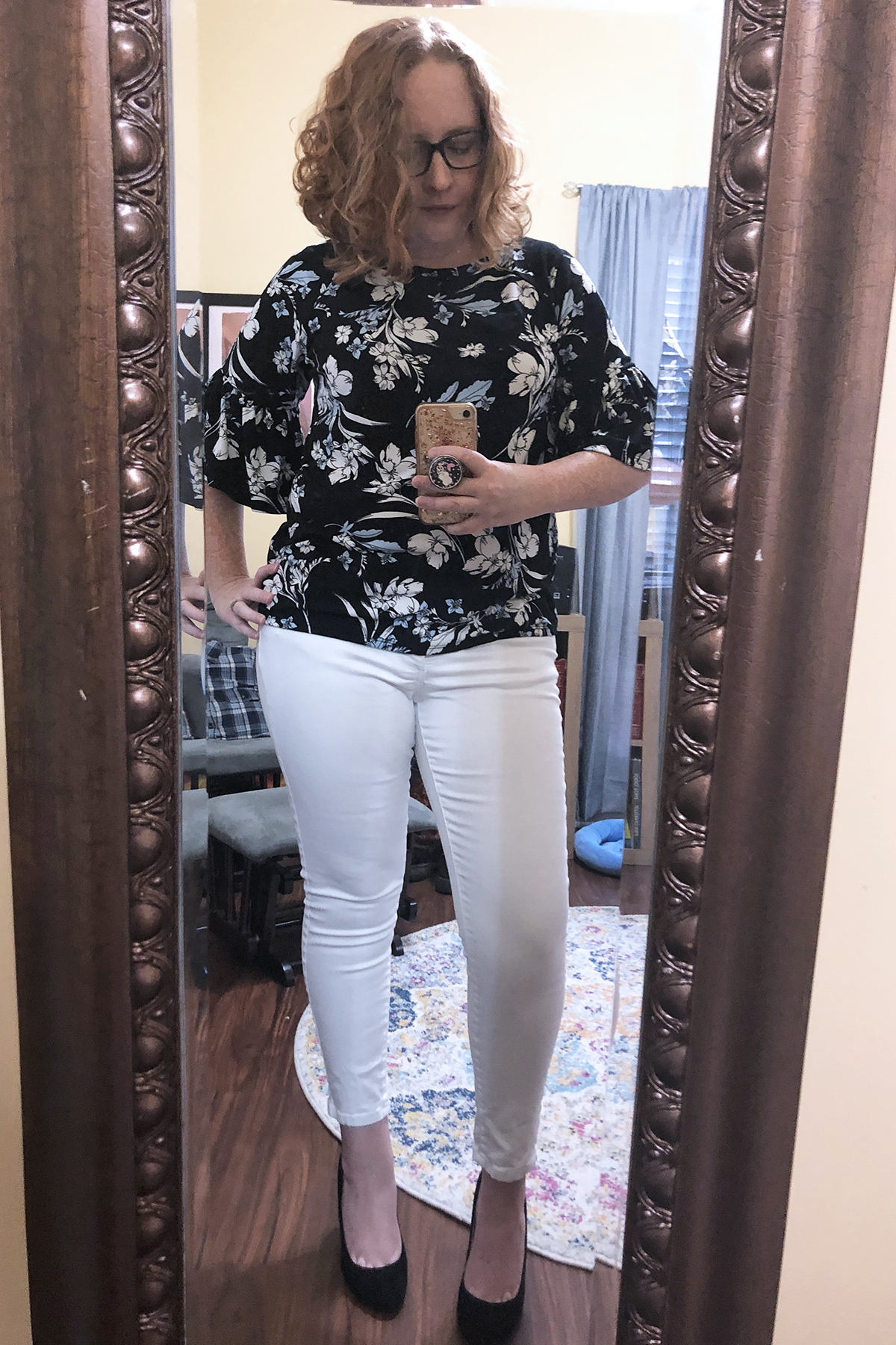 white jeans black and blue blouse