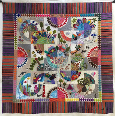 Evelyn's 'Over the Hill' felt applique quilt
