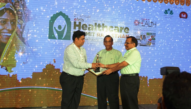 Dr. S C Pareek, MD, BMCHRC and Dr. Prem Singh Lodha, ED, BMCHRC receiving the award from Mr. Naveen Jain, Mission Director (NHM), Medical, Health & Family Welfare, Government of