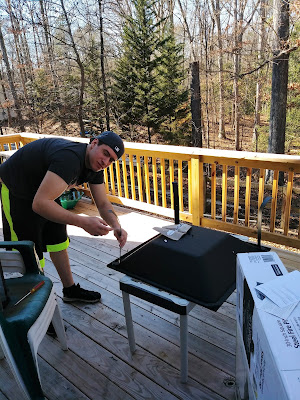 Zack putting together the fire pit he bought at Walmart and gave to us for Christmas.