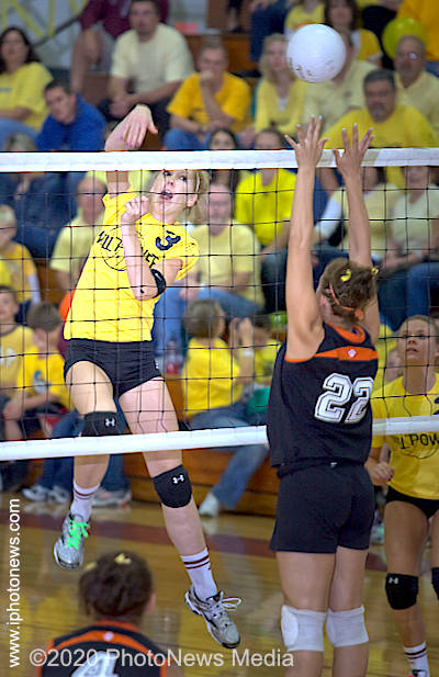 Bria Olson puts the ball away for a kill