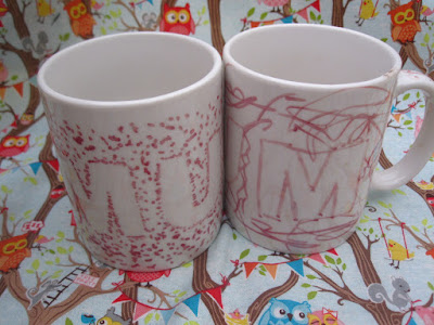 Pair of mugs decorated with sharpie pens