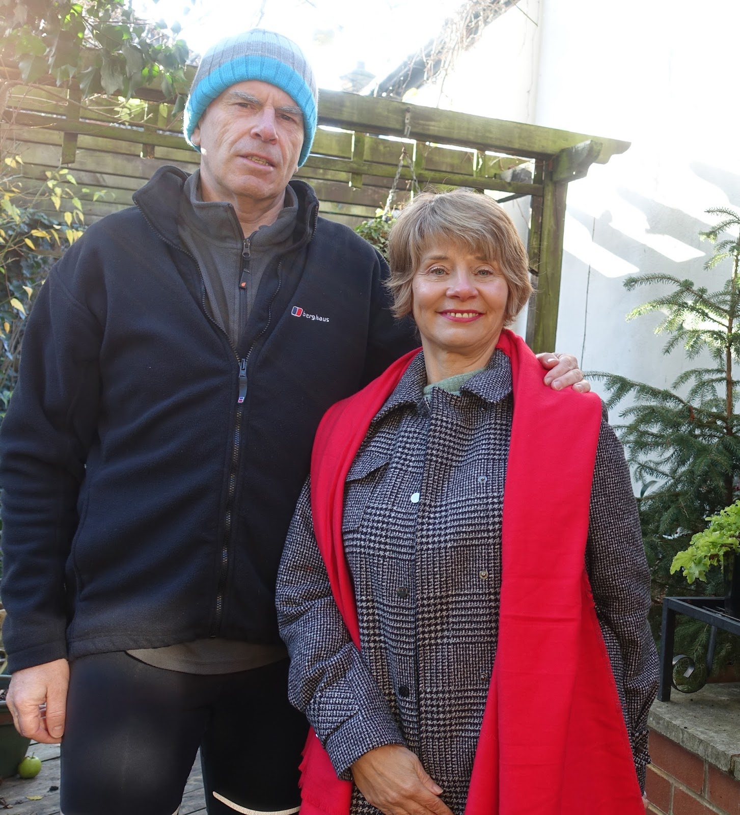 Image showing a couple in their 50s dressed for cold weather in their London garden
