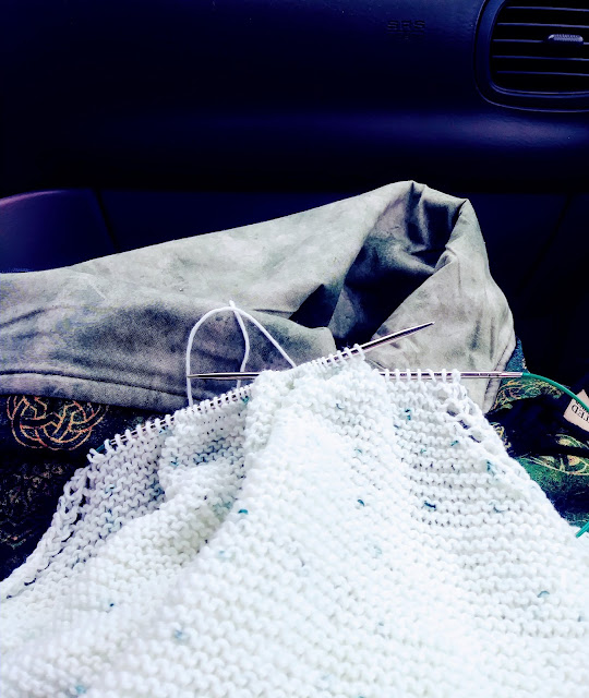 Almost finished knitting this baby blanket in the car while driving to the new house