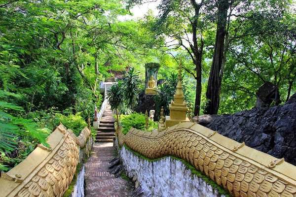 Stairs rise to the Phou Si Hill