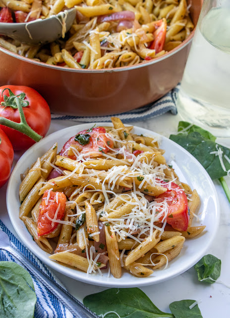 This copycat Pasta Fresca recipe from Noodles and Company is such an easy meal that's ready in less than 30 minutes! Add your favorite protein like chicken, shrimp or beef or keep it as a meatless vegetarian meal! Save money and make this restaurant favorite at home!
