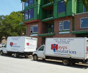 The Hayes Company Trucks at an insulation project.