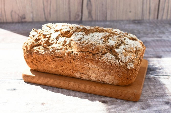 Loaf of Wholemeal Beer Bread on a Wooden Board