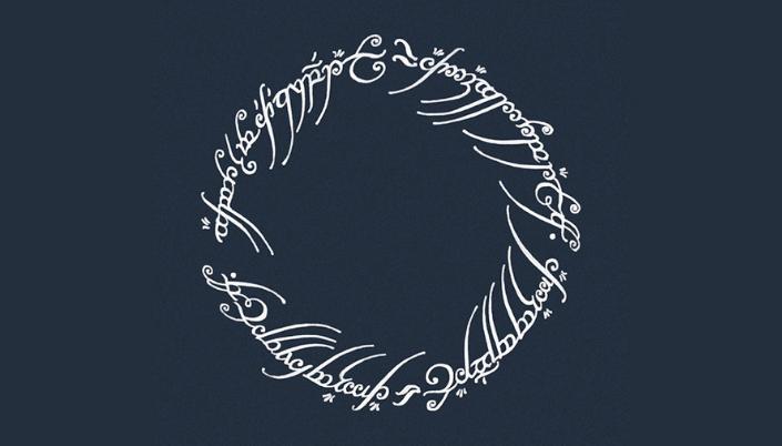 O fundo é cinza aí no centro tem uma runa circular com várias palavras em élfico, é inscrição que tem dentro do anel de O Senhor dos Anéis.