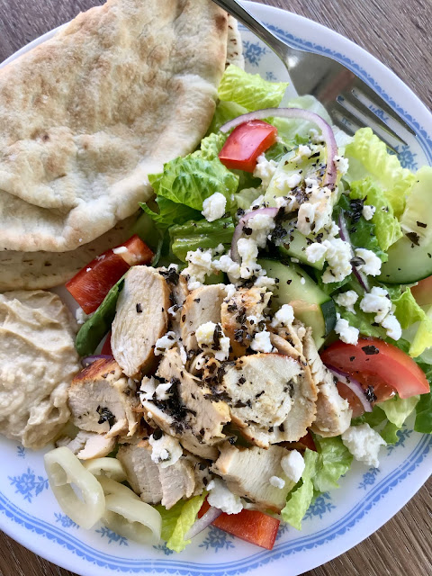 Greek salad topped with homemade Greek dressing.