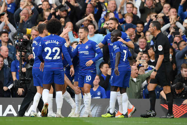 Eden Hazard of Chelsea celebrates with teammates after scoring the opening goal during the Premier League match between Chelsea FC and Liverpool FC at Stamford Bridge on September 29, 2018 in London, United Kingdom.