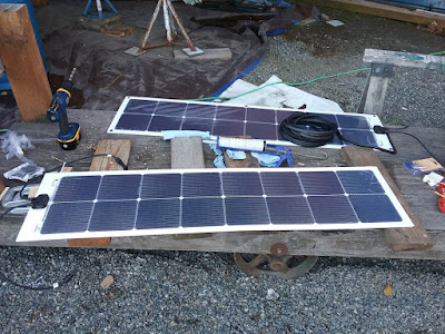 The new solar panels, in the process of having holes drilled for grommets.