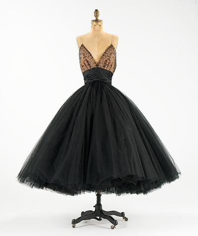Black Silk Evening Dress by Norman Norell 1955 displayed on dress form