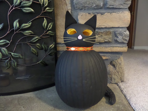 black cat carved pumpkin with glowing eyes