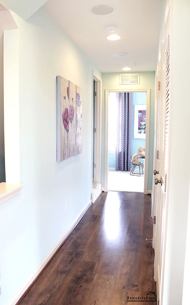 a simple hallway without clutter with hardwood floors