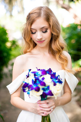 bride with off shoulder dress and vibrant bouquet